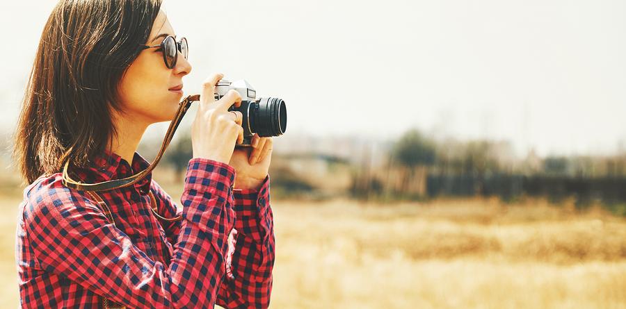 Tourist Woman Takes Photographs With Vintage Photo Camera